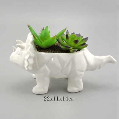 white ceramic dinosaur filled plants